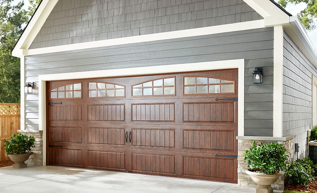 A detached garage with a double-sized garage door.