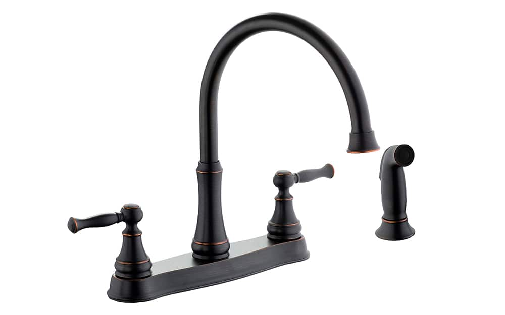 A standard two-hole deck plate faucet with side sprayer.
