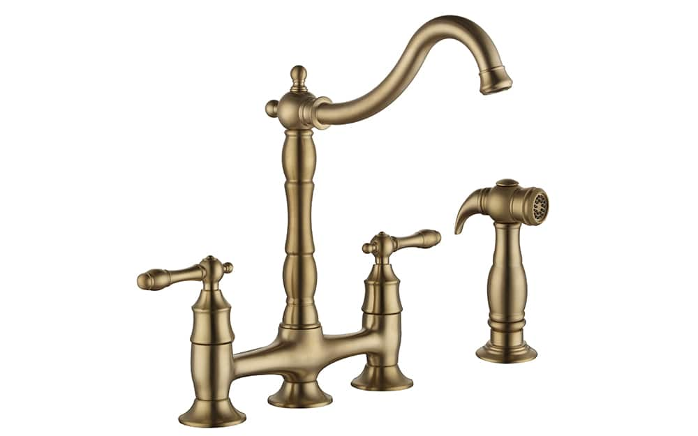A two-handle faucet in a gold finish.