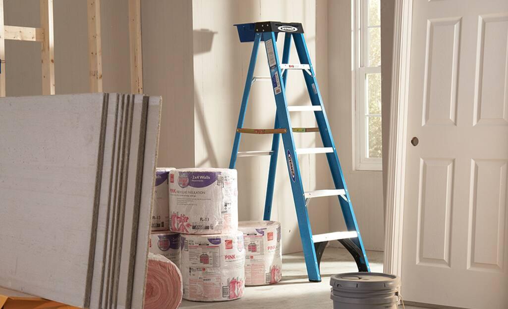 A blue aluminum step ladder.