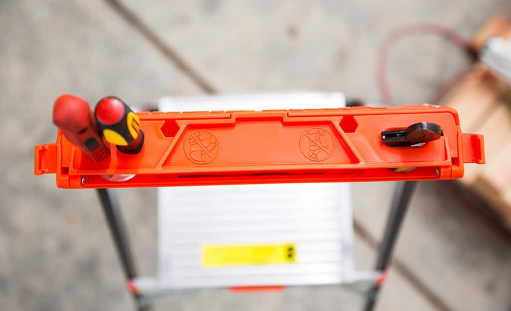 Top view of a ladder with a tool holder.
