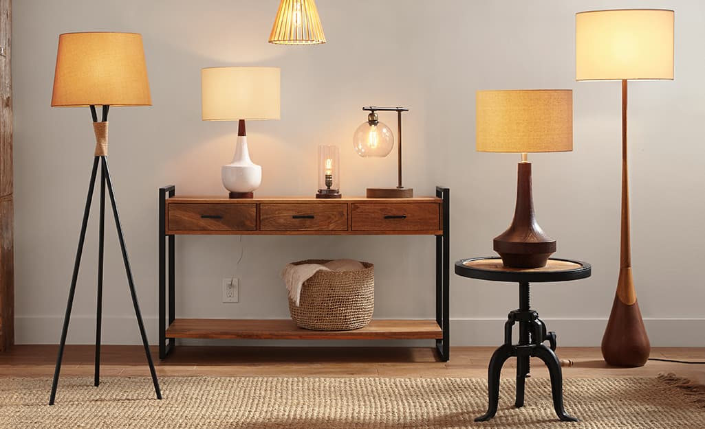 Several types of lamp shades in a room.
