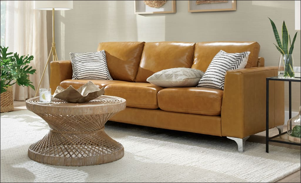 a mustard colored leather sofa in a living room