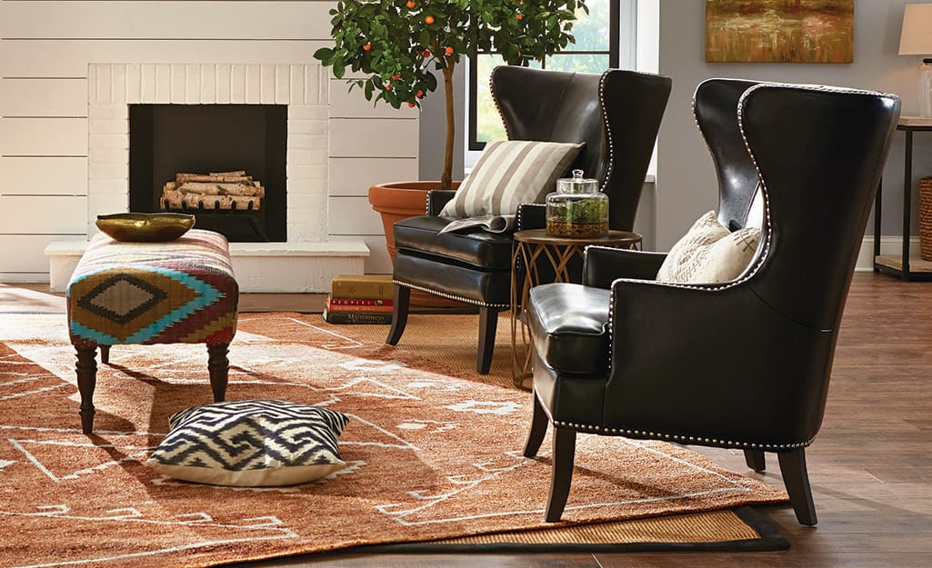 two leather accent chairs in a living room