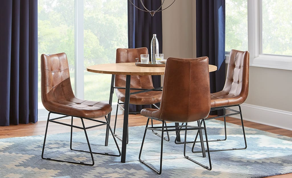 leather dining chairs around a table in a dining room