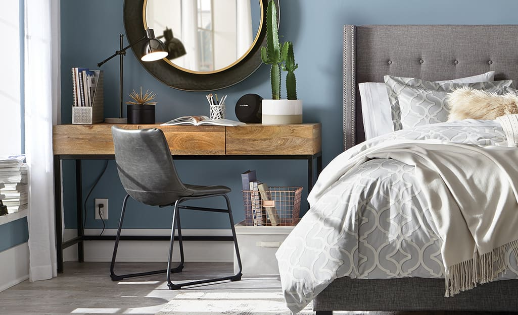 a leather accent chair at a desk in a bedroom