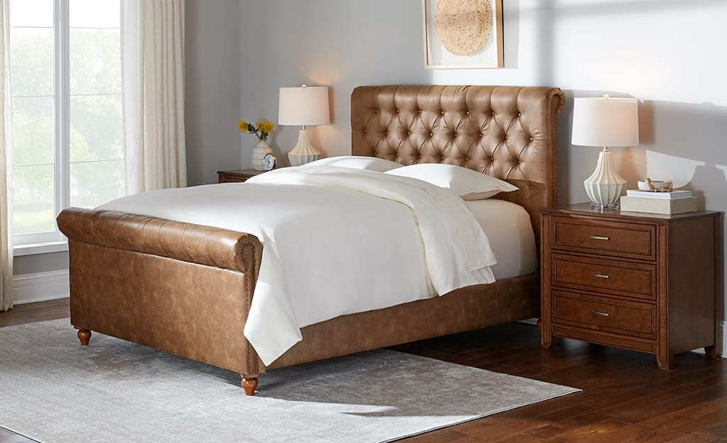 a leather bed frame in a living room