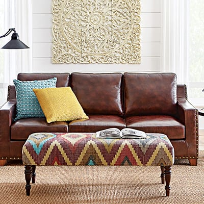 a brown leather sofa in a living room