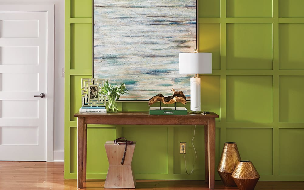 An entryway painted in a bold shade of green.