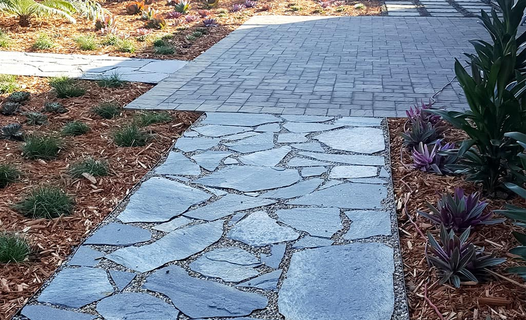 A walkway and stoop made of natural stone.