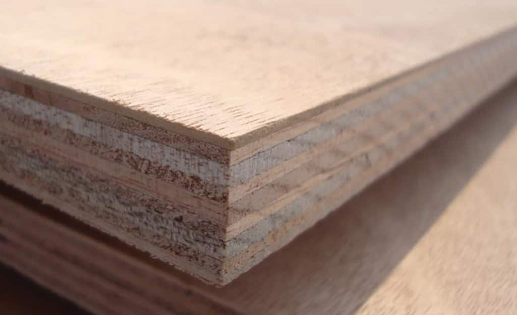 Close up of a multi-ply plywood panel that shows the distinct layers of veneer.