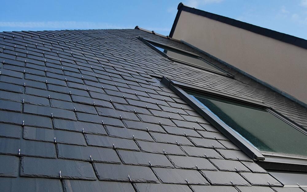 A slate roof with a sky light.
