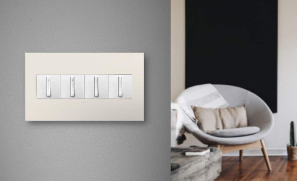 Toggle light switches with a jumbo 4-gang wall plate.