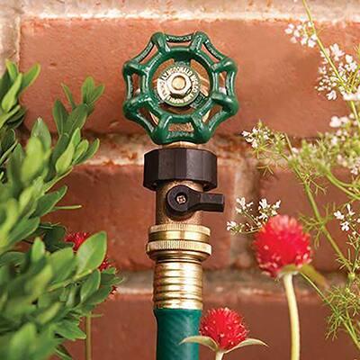A garden hose attached to a hose bibb.