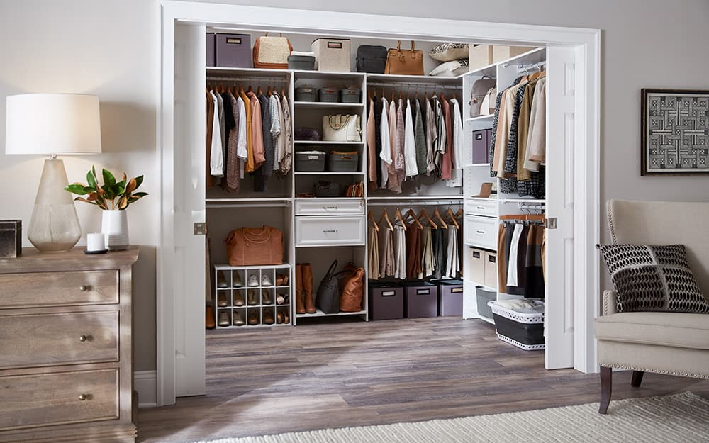 A closet system creates a fully organized space.