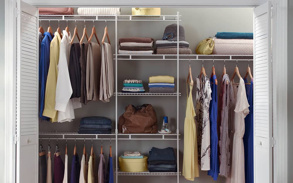 A wire closet system featuring shelves and hanging rods.