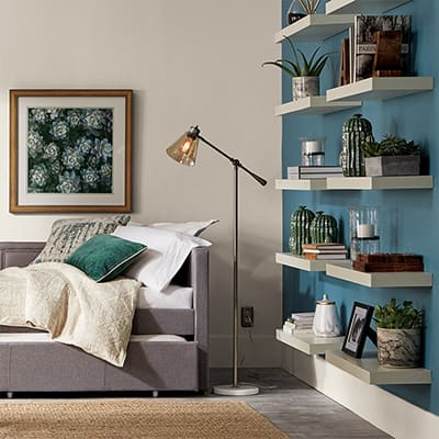 Accessories on bookshelves used as wall art.
