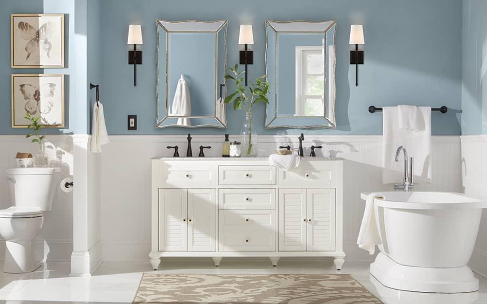 A bathroom featuring beadboard wall paneling.