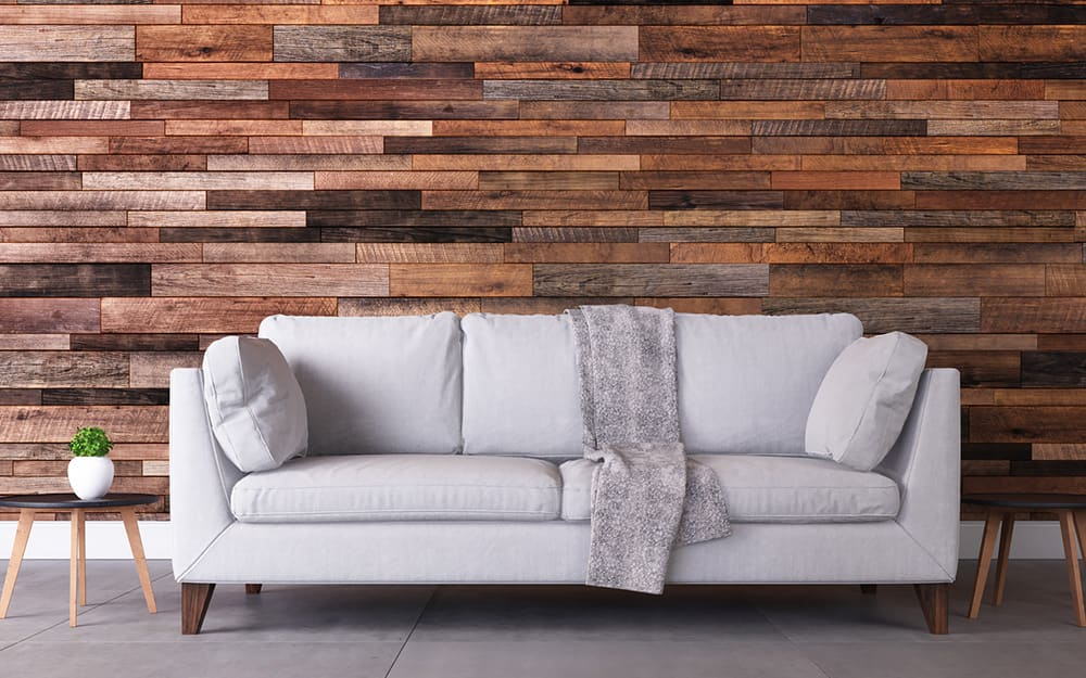 A wall with wooden paneling.