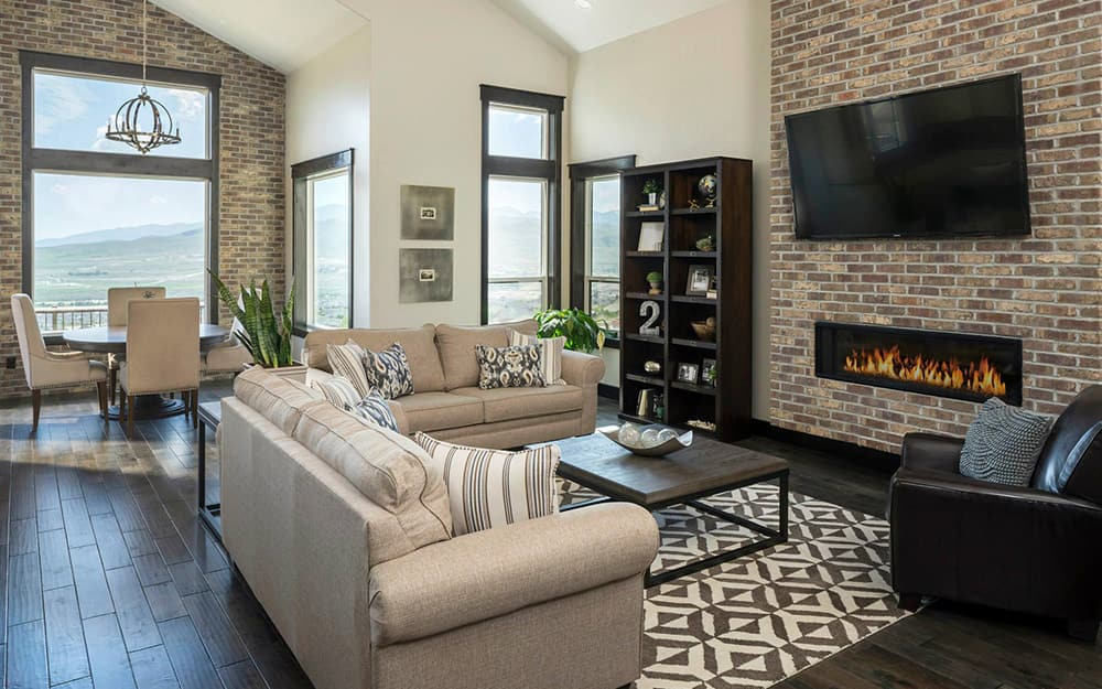 A living room with brick style wall paneling.