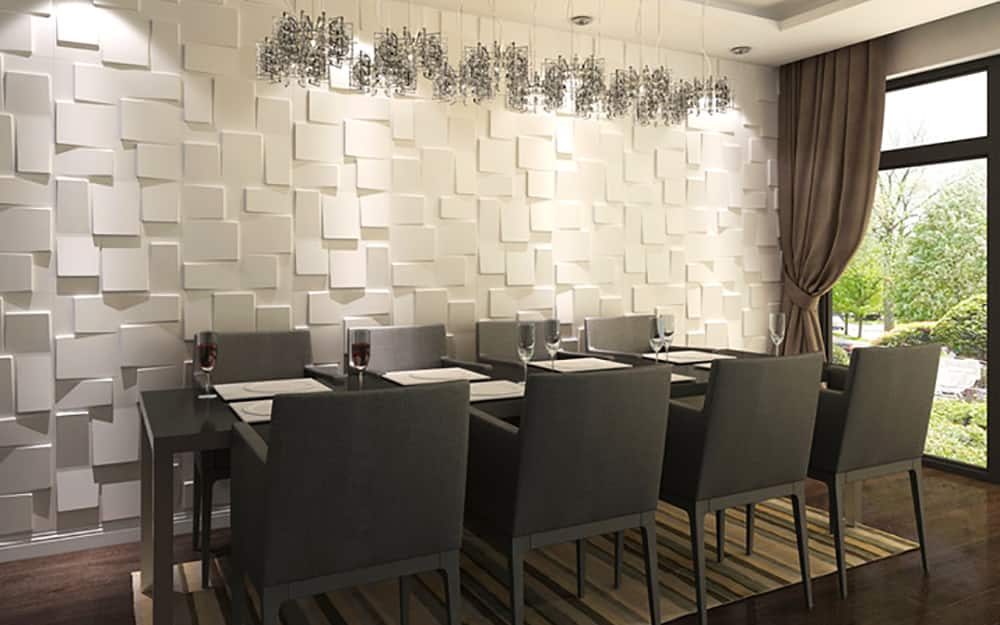 A dining room featuring 3d style wall paneling.