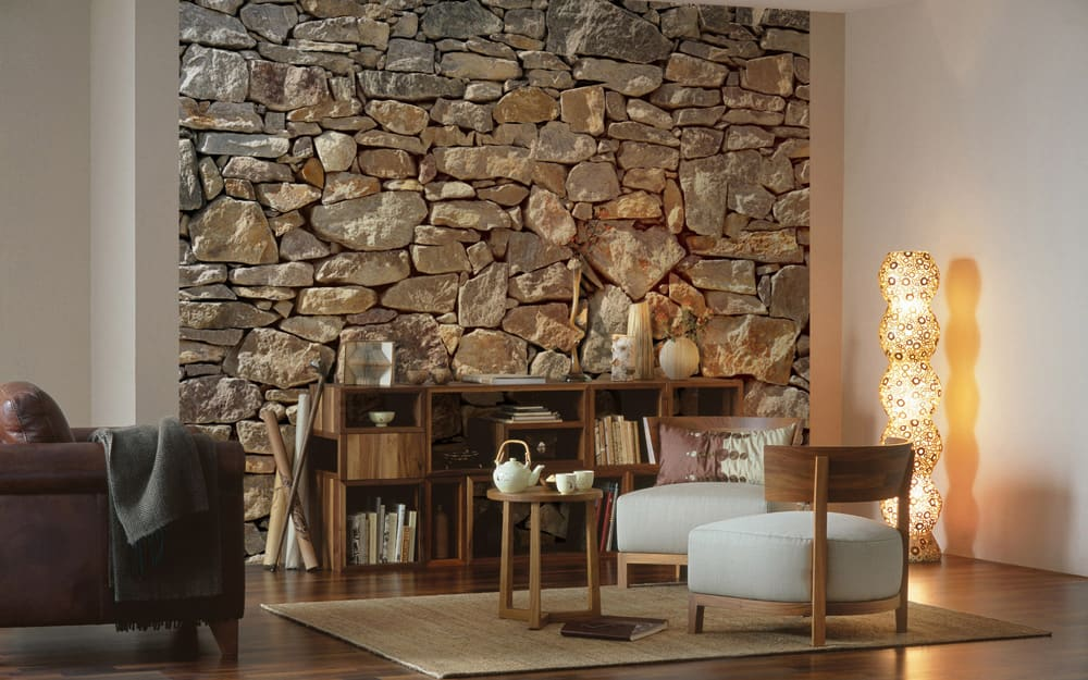 A living room featuring stone wall paneling on an accent wall.