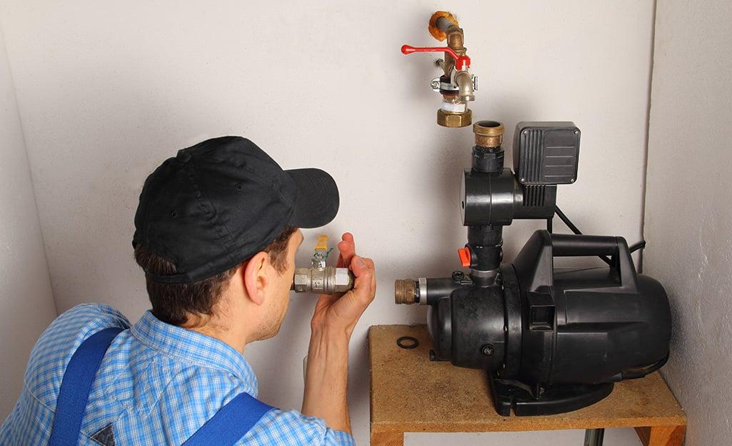 Man installing a utility pump.