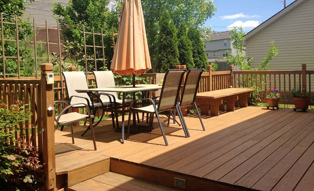 A large wood deck with patio furniture.