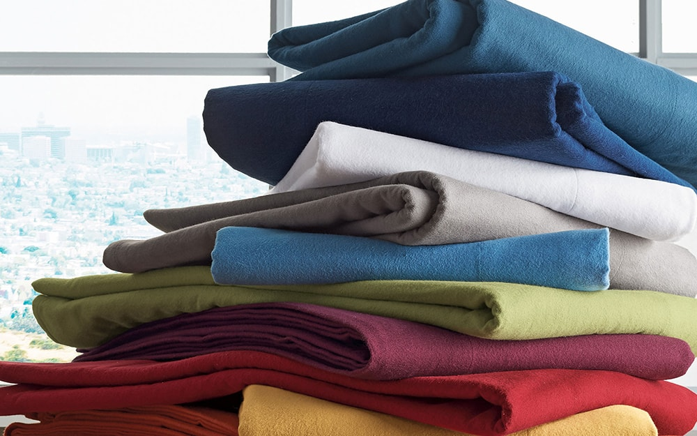 Colorful duvet covers stacked in a pile.