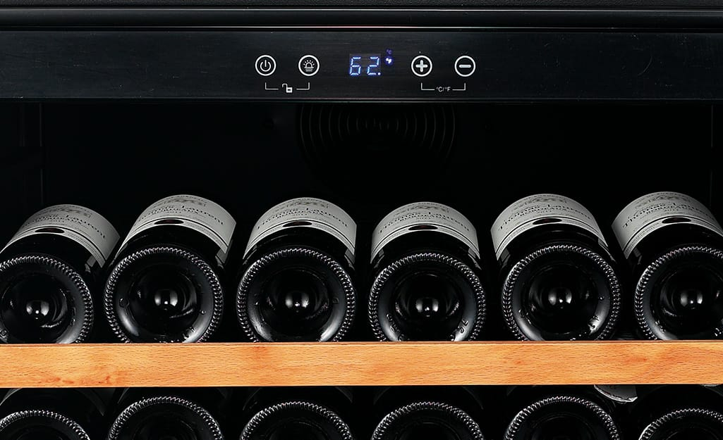 A wine cooler thermometer set to 62 degrees.