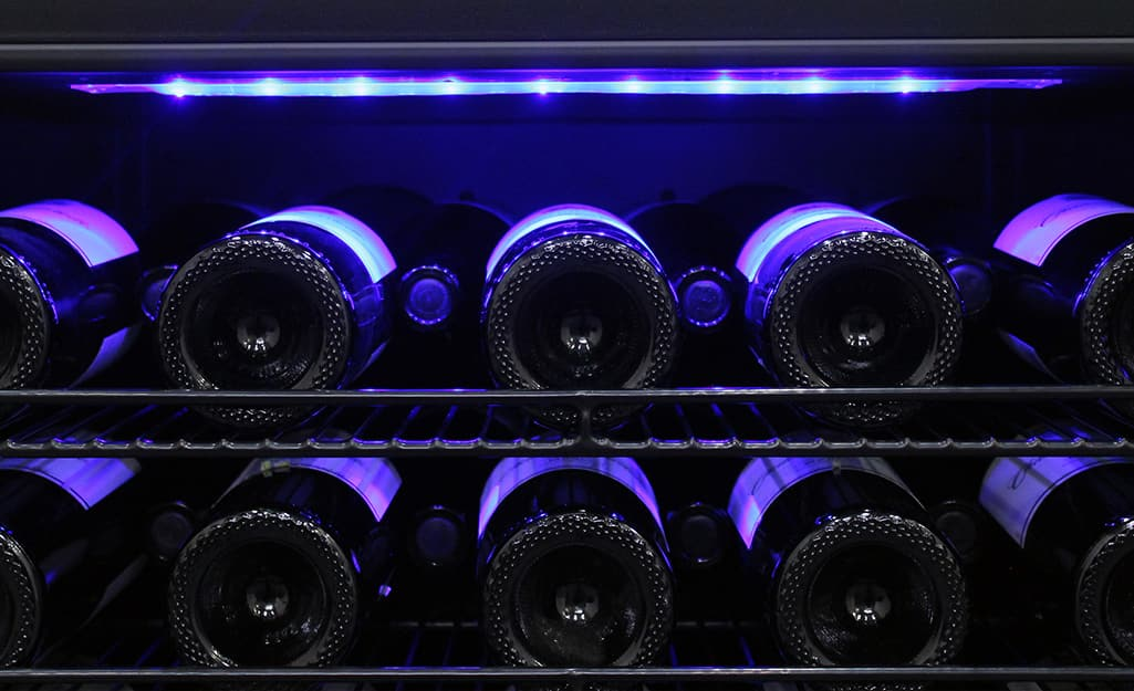 A wine cooler features special lighting to reduce UV exposure.