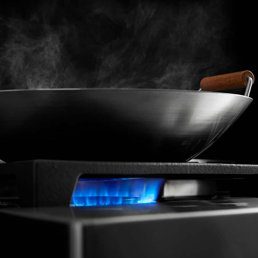 Two 20000 BTU Dual-Flame Burners for high- and low-heat cooking.
