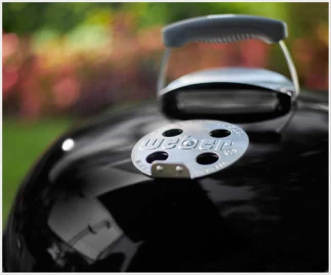 The heat shield helps prevent your lid handle from getting too hot.