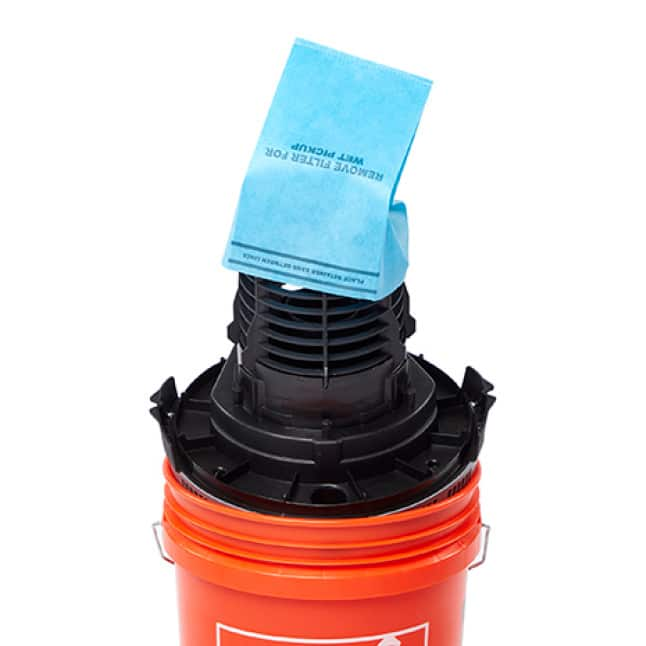 Detach the lid and place the motor upside down in the drum. Locate the filter cage. Place filter on top.