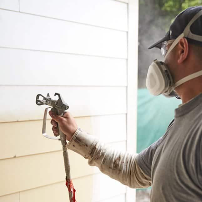 Apply KILZ Primer on exterior wall with sprayer