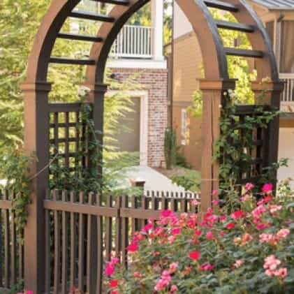 Exterior wood arbor and picket gate coated with Solid Color Wood Stain - Brown color Chocolate SC-129