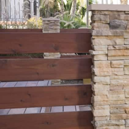 Horizontal fence stained with Semi-Transparent Wood Stain - Brown color Russet ST-117