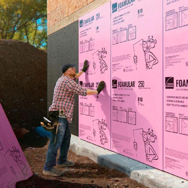 man installing Foamular in exterior foundation application