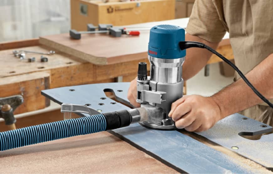Hands on Bosch Router tool cutting in template guide.