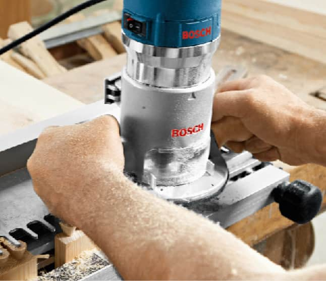Bosch router in use for wood project.