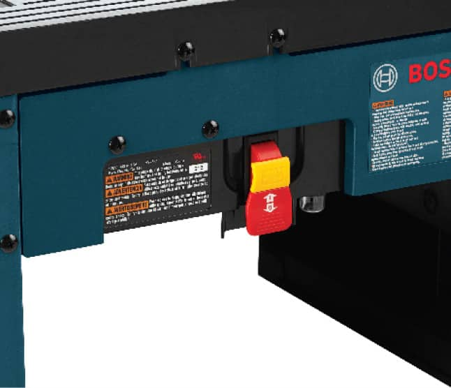 Close up of power cord lock on back of router table