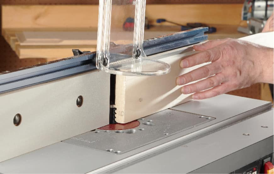 Bosch router table cutting wood with guard up