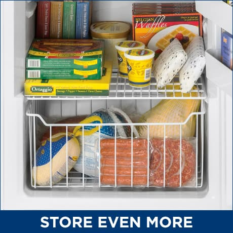 Organized food items inside of the freezer in a slide-out basket