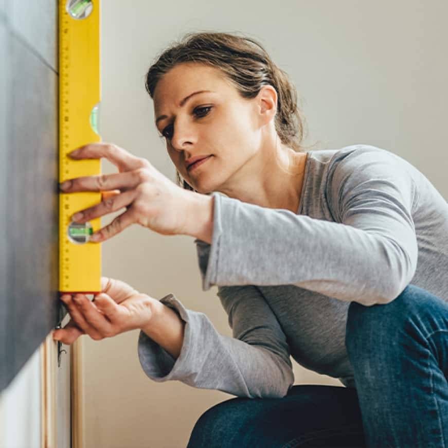 Woman using a level