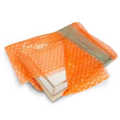 Picture frame wrapped in bubble cushion wrap bundled and stretch wrap