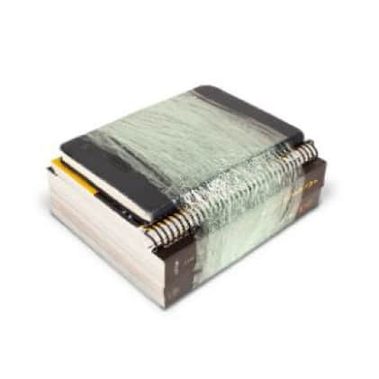 Reading books and notebooks bundled with stretch wrap