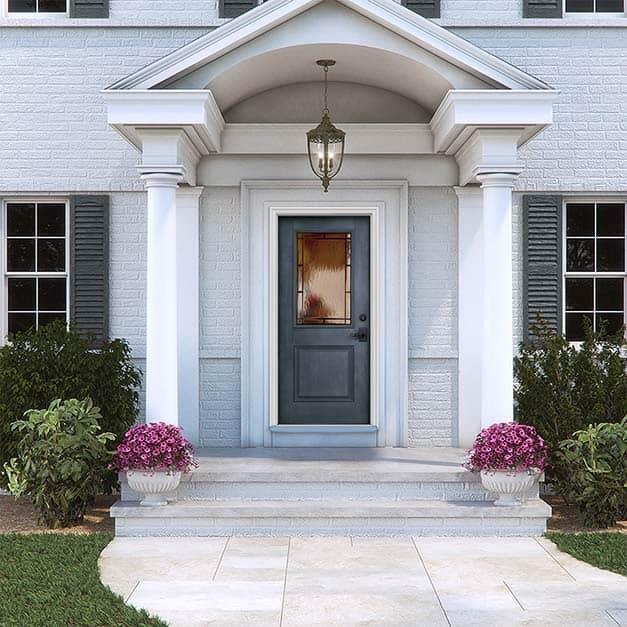 Exterior home with denim stain fiberglass door with decorative glass