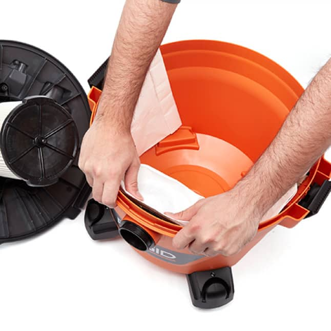 With both thumbs push the back of the collar until the cardboard is pressed all the way against the vac.