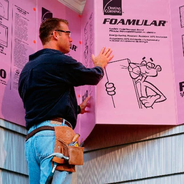 man installing Foamular fanfold insulation