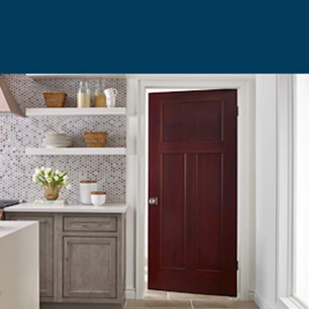Stained Craftsman molded door that matches design of kitchen